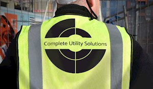 Image showing a construction worker on site wearing a Complete Utility Solutions ppe jacket